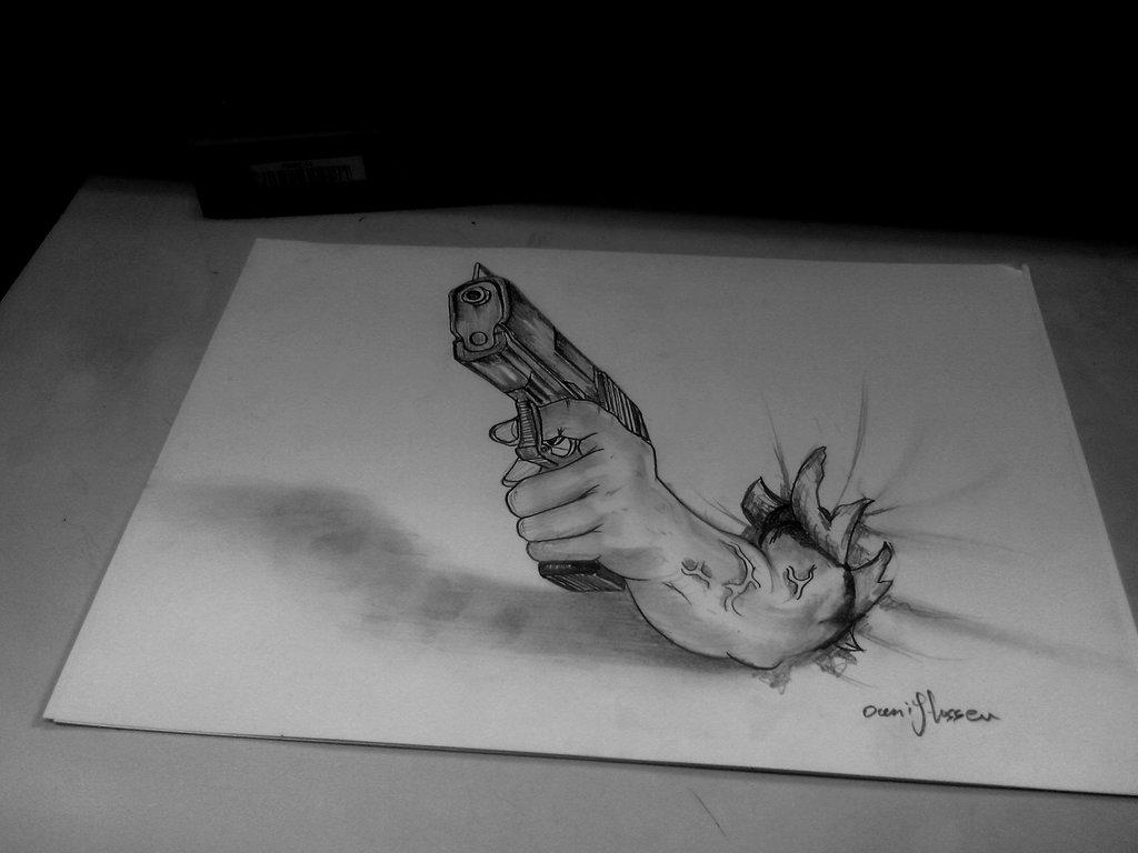 Drawn gun handgun Ghassen by by holding hand