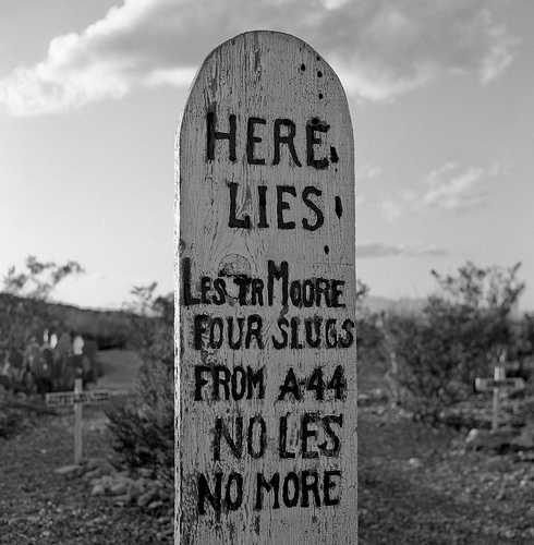Drawn headstone here lies A four slugs lies Lester