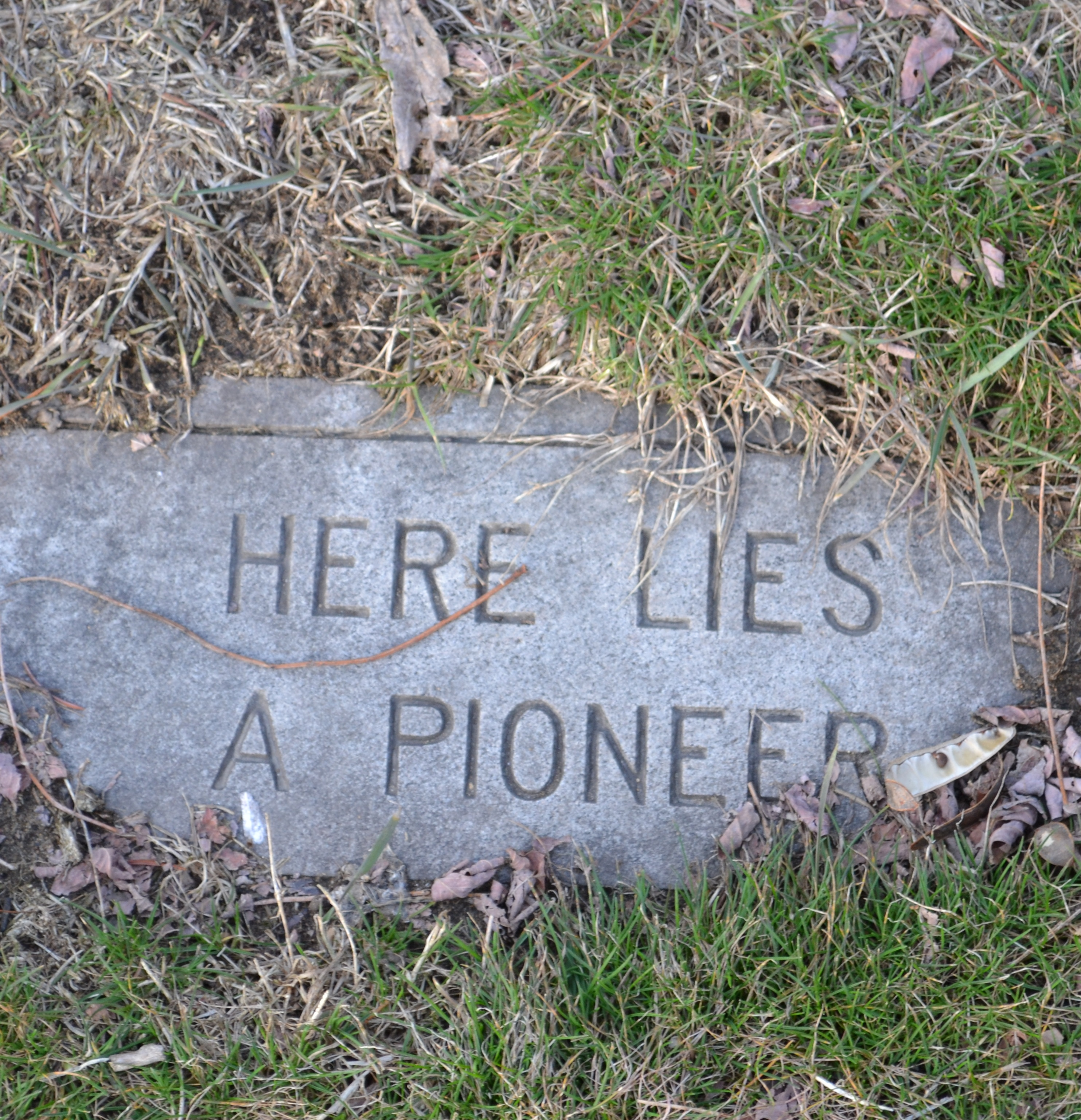 Drawn headstone here lies In A of Lies marker