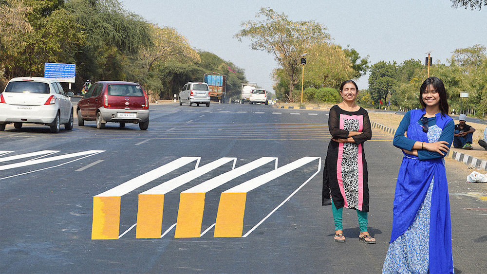 Drawn optical illusion road Into slowing drivers illusion trick