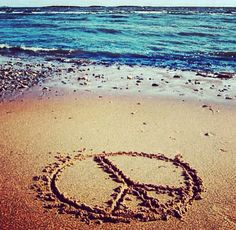 Drawn peace sign sand In photo names Sand sign