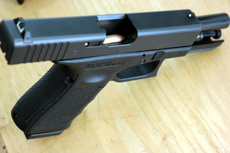 Drawn pistol glock 19  Why — I –