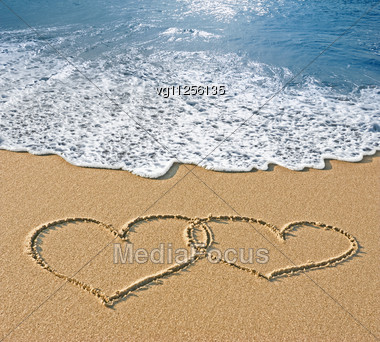 Drawn sand smiley face Image Sand Drawn Seafoam Wave