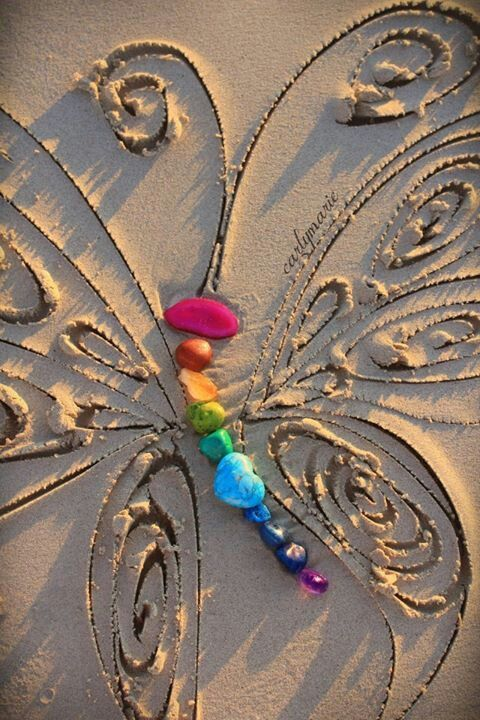 Drawn sand butterfly Colorful body the sculptures &