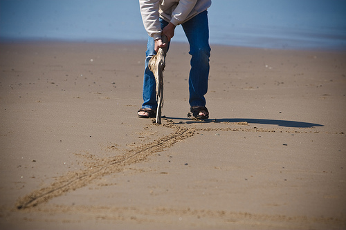 Drawn sand line in Leadership Like The Sand Scott