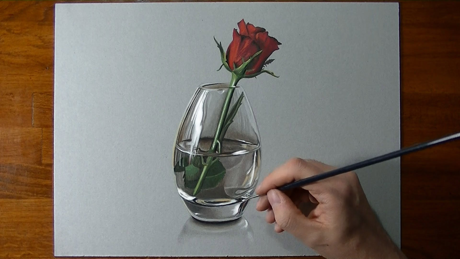 Drawn red rose real rose Glass red vase in a