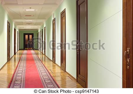 On wood of carpet hallway