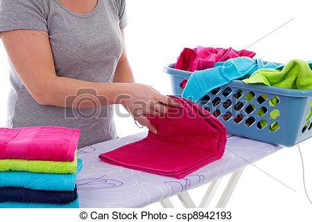 Towel clipart folded clothes Of Stock Housewife folding in