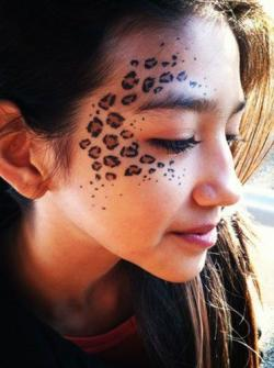 Drawn leopard skin face painting